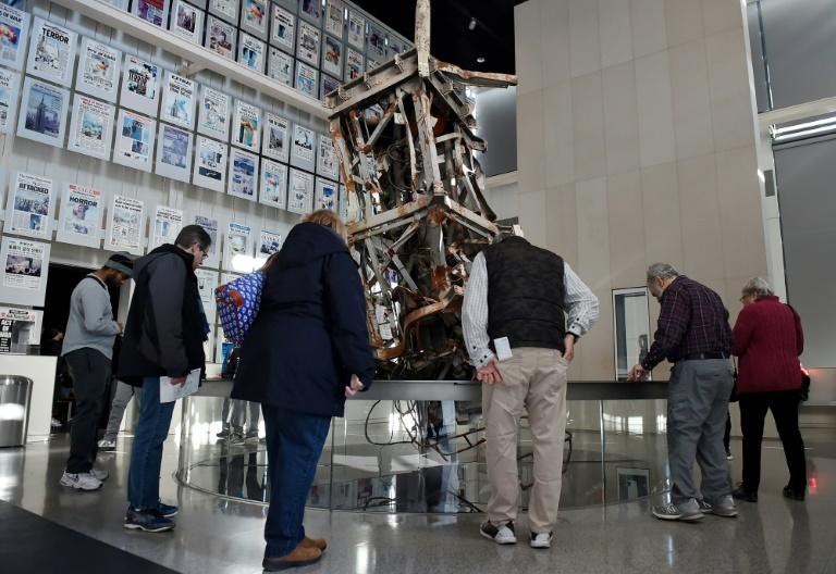 Visitors to the Newseum view a section of the television antenna that once sat atop the World Trade Center's north tower, part of the exhibit on the media and the attacks of September 11, 2001