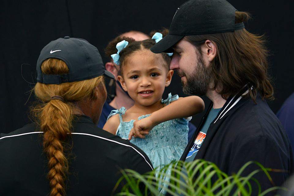 Serena Williams (L) of the US and her husband Alexis Ohanian talk to their daughter Alexis Olympia Ohanian Jr during the 'A Day at the Drive' exhibition tournament in Adelaide on January 29, 2021. (Photo by Brenton Edwards / AFP) / -- IMAGE RESTRICTED TO EDITORIAL USE - STRICTLY NO COMMERCIAL USE -- (Photo by BRENTON EDWARDS/AFP via Getty Images)