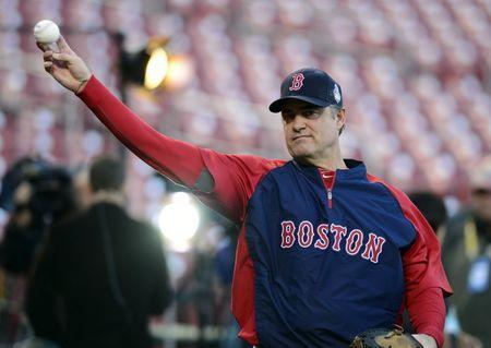FILE PHOTO: Oct 25, 2013; St. Louis, MO, USA; Boston Red Sox manager John Farrell (53) throws during workouts a day before game three of the World Series against the St. Louis Cardinals at Busch Stadium. Mandatory Credit: Jeff Curry-USA TODAY Sports
