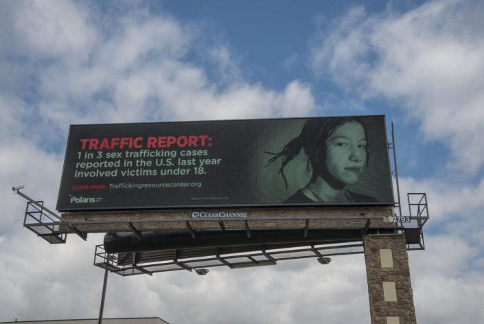 """<span class=""""caption"""">A billboard in Mounds View, Minnesota, put up by the nonprofit National Human Trafficking Resource Center. </span> <span class=""""attribution""""><a class=""""link rapid-noclick-resp"""" href=""""https://www.gettyimages.com"""" rel=""""nofollow noopener"""" target=""""_blank"""" data-ylk=""""slk:Education Images/Universal Images Group via Getty Images"""">Education Images/Universal Images Group via Getty Images</a></span>"""