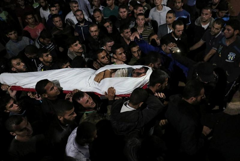 The body of Palestinian Marwan Alagha, 22, is carried by mourners in the Gaza Strip after he was killed when Israel blew up what it said was a tunnel stretching from Gaza into its territory (AFP Photo/SAID KHATIB)