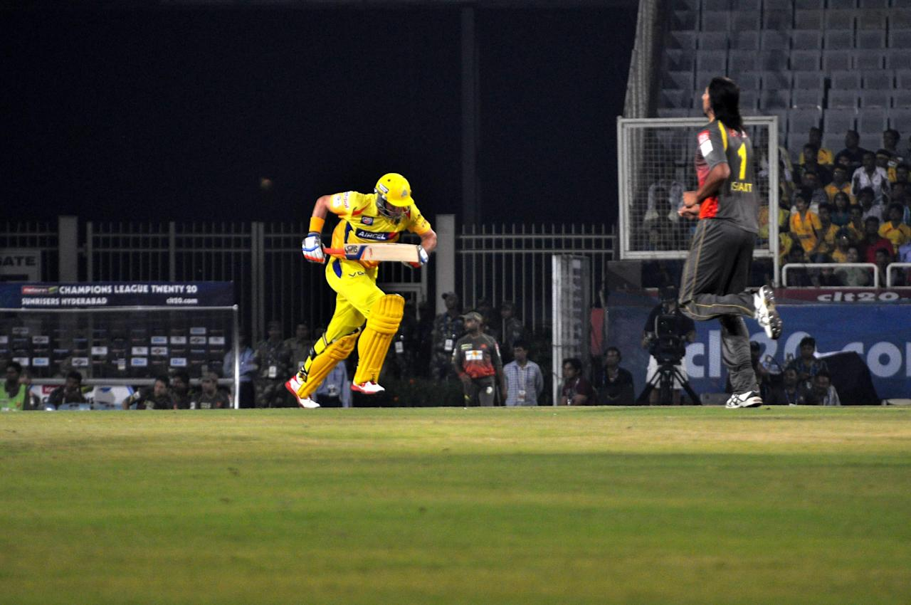Michael Hussey of Chennai Super Kings takes a run as Ishant Sharma of Sunrisers Hyderabad watches at JSCA International Cricket Stadium, Ranchi on Sept. 26, 2013. (Photo: IANS)
