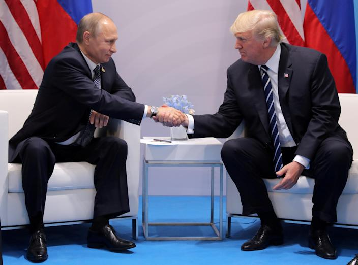 President Trump shakes hands with Russia's President Vladimir Putin during their bilateral meeting at the G-20 summit in Hamburg, Germany, in July 2017. (Carlos Barria/Reuters)