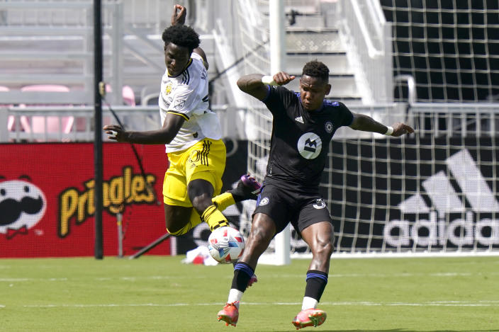 Columbus Crew defender Aboubacar Keita, left, and CF Montréal forward Romell Quioto, right, go for the ball during the first half of an MLS soccer match, Saturday, May 1, 2021, in Fort Lauderdale, Fla. (AP Photo/Lynne Sladky)