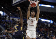 Florida State's Anthony Polite (13) dunks against Murray State's Brion Sanchious (4) during the second half of a second round men's college basketball game in the NCAA Tournament, Saturday, March 23, 2019, in Hartford, Conn. Florida State won 90-62. (AP Photo/Elise Amendola)