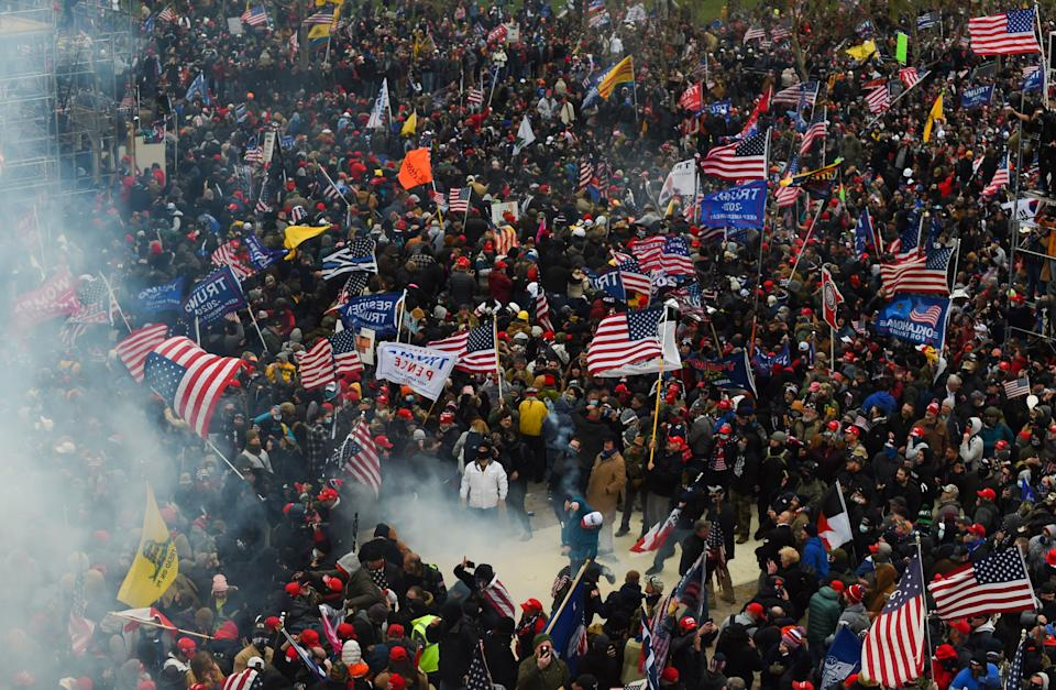 Trump supporters clash with police and security forces as they storm the U.S. Capitol on Jan. 6. Demonstrators entered the Capitol as Congress was gathered to count the 2020 presidential election Electoral College votes. (Photo: ROBERTO SCHMIDT/AFP via Getty Images)