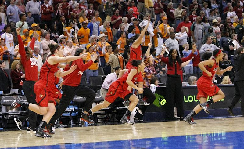 Louisville's bench celebrates after defeating Baylor 82-81 in a regional semifinal in the women's NCAA college basketball tournament in Oklahoma City, Sunday, March 31, 2013. (AP Photo/Alonzo Adams)