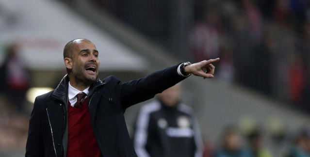 Bayern head coach Pep Guardiola of Spain gestures during the German first division Bundesliga soccer match between FC Bayern Munich and Bayer 04 Leverkusen, in Munich, southern Germany, Saturday, March 15, 2014. (AP Photo/Matthias Schrader)