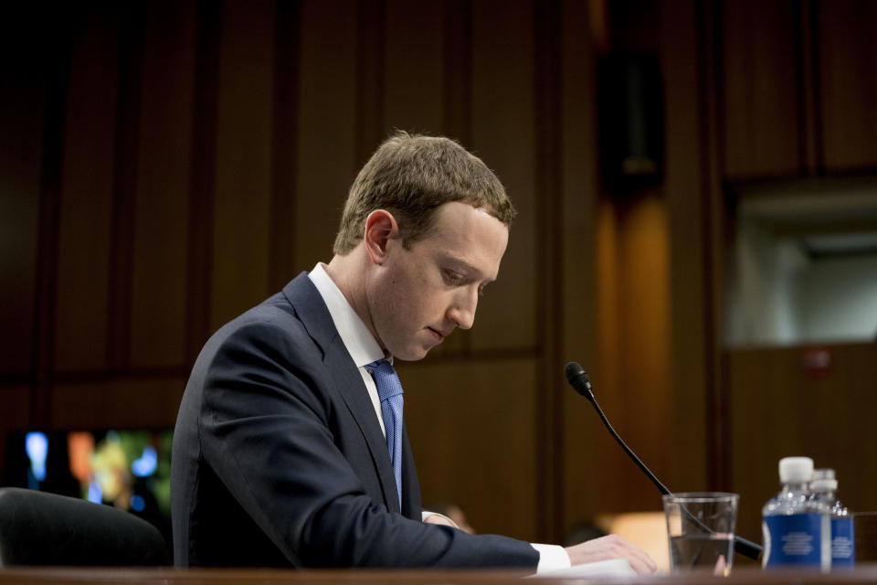 Facebook CEO Mark Zuckerberg pauses while testifying before a joint hearing of the Commerce and Judiciary Committees on Capitol Hill in Washington about the use of Facebook data to target American voters in the 2016 election. Facebook shares tumbling on Thursday after the company reported a poor second quarter Wednesday afternoon. (AP Photo/Andrew Harnik)