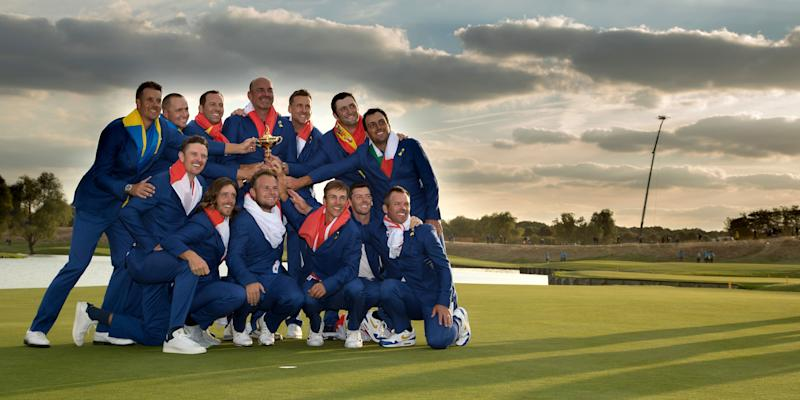 The European Team celebrate with the trophy after securing victory in the singles matches of the 2018 Ryder Cup.