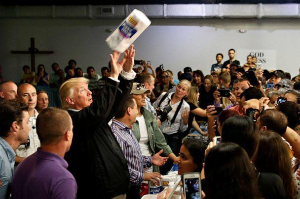PHOTO: President Donald Trump tosses rolls of paper towels to people at a hurricane relief distribution center at Calvary Chapel in San Juan, Puerto Rico, Oct. 3, 2017. (Jonathan Ernst/Reuters, File)