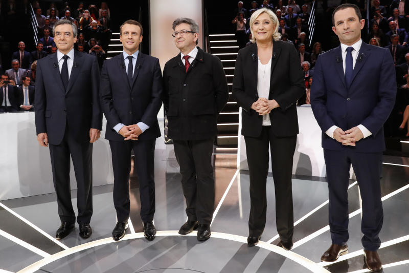 Macron, Le Pen clash in first French election TV debate
