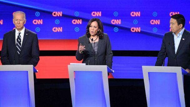 PHOTO: Kamala Harris delivers her closing statement flanked by Joe Biden and Andrew Yang during the second round of the second Democratic primary debate in Detroit, Michigan on July 31, 2019. (Jim Watson/AFP via Getty Images)