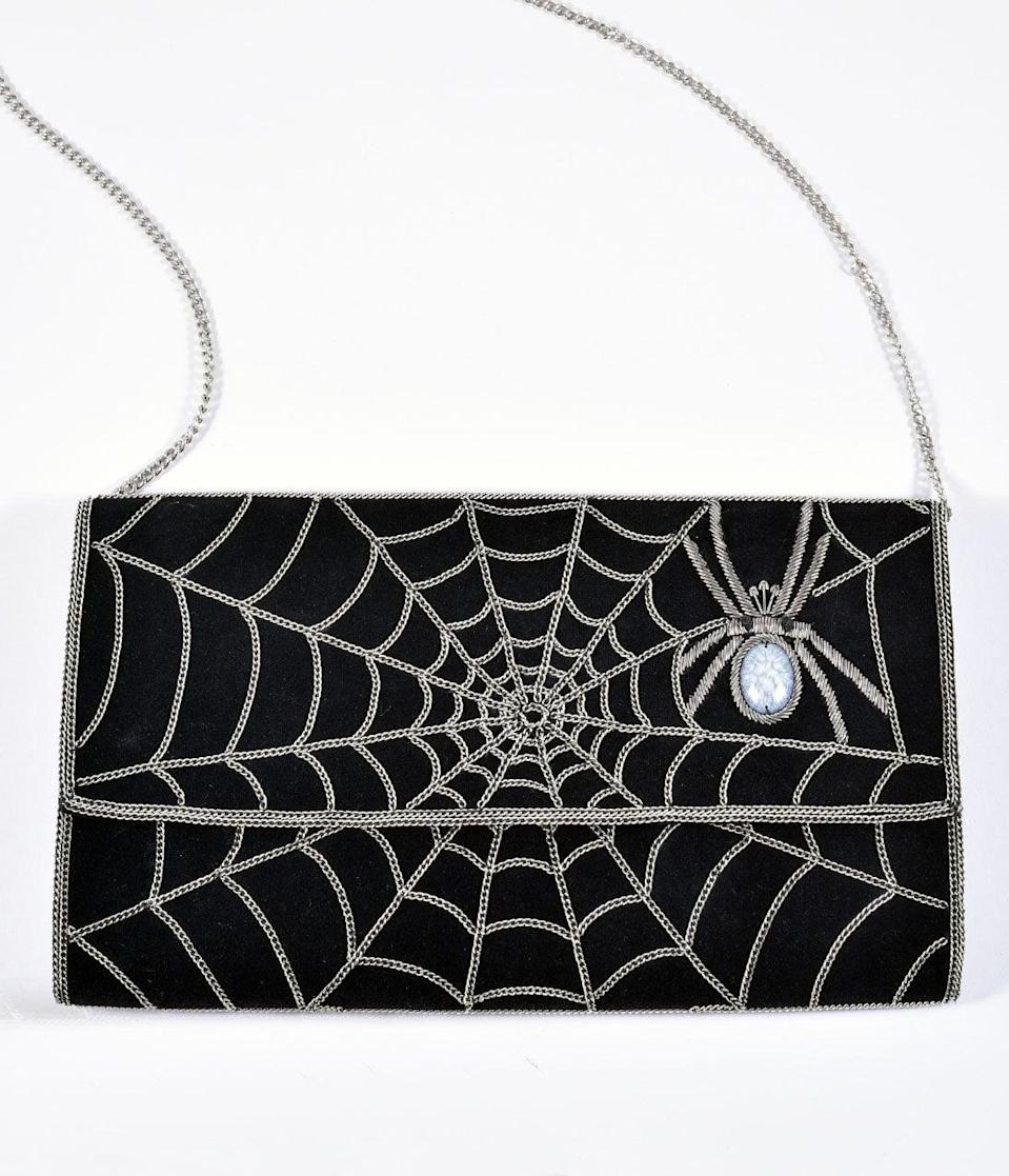 <p>Make any outfit a creepy one with this <span>Black Suede and Silver Chain Spiderweb Envelope Clutch</span> ($86).</p>