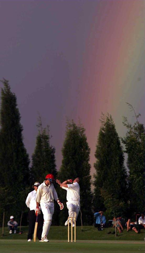 01 Nov 1999:  Darren Gough of England bowls at the foot of a rainbow at the NFO XI Ground and Pavillion in Randjesfontein, South Africa. Mandatory Credit: Laurence Griffiths/ALLSPORT