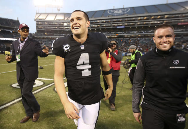 """For <a class=""""link rapid-noclick-resp"""" href=""""/nfl/players/27564/"""" data-ylk=""""slk:Derek Carr"""">Derek Carr</a> and the Raiders smiles have rarely cracked. Can the passed over QB bring similar happiness to fantasy owners in Week 15? (AP Photo/Ben Margot)"""