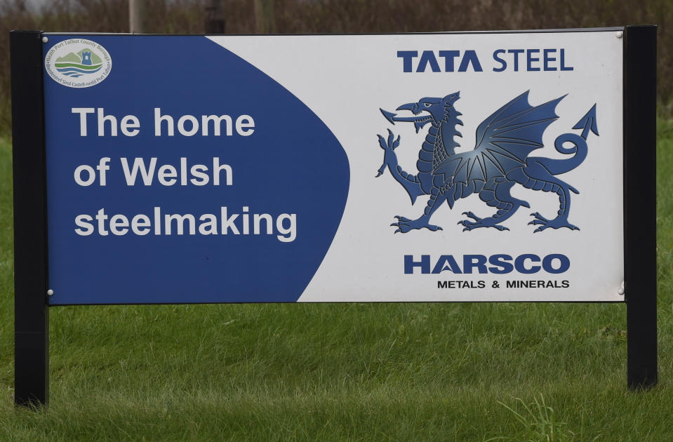 A sign on a roundabout advertises the Tata steelworks in Port Talbot, Wales, Britain January 18, 2016. Britain's largest steelmaker Tata Steel Ltd said on Monday that it would cut 1,050 UK jobs, in another blow for an industry reeling from cheap imports and tumbling world prices. The plan involves shedding 750 jobs at Tata's Port Talbot-based strip products business in Wales, 200 jobs in support functions and 100 jobs at steel mills around the country, the company said in a statement.   REUTERS/Rebecca Naden