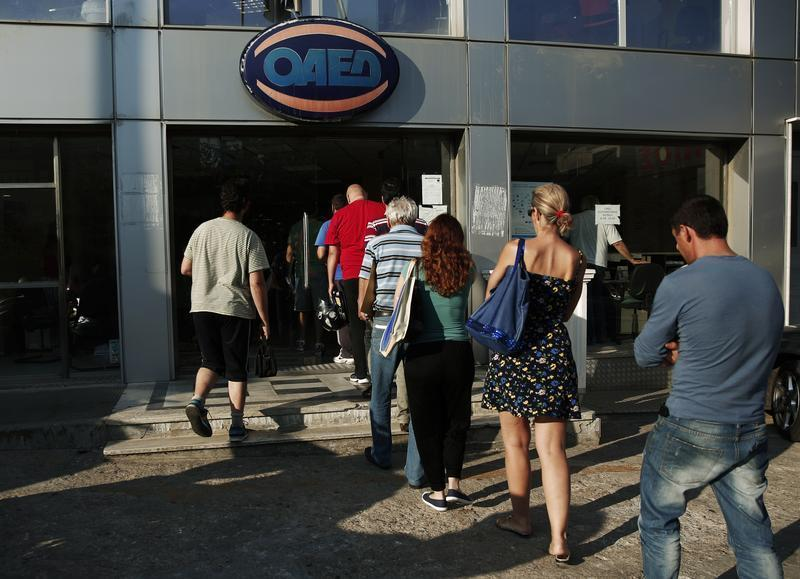 People enter a Greek Manpower Employment Organisation (OAED) office in a northern suburb of Athens
