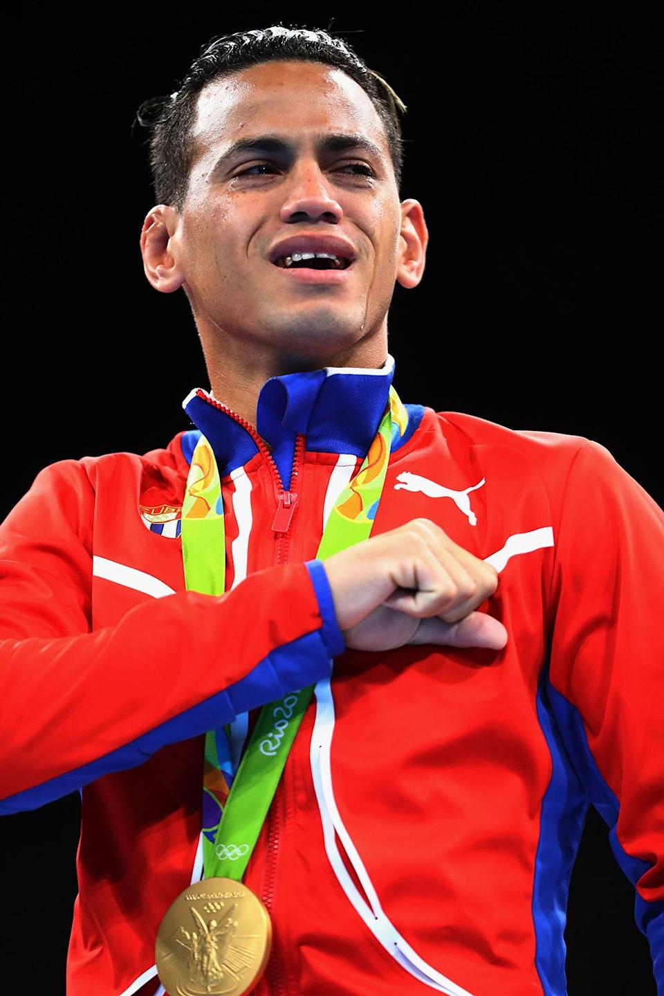 <p>Gold medalist Robeisy Ramirez of Cuba poses during the medal ceremony for the Men's Bantam (56kg) on Day 15 of the Rio 2016 Olympic Games at Riocentro – Pavilion 6 on August 20, 2016 in Rio de Janeiro, Brazil. (Photo by Dean Mouhtaropoulos/Getty Images) </p>