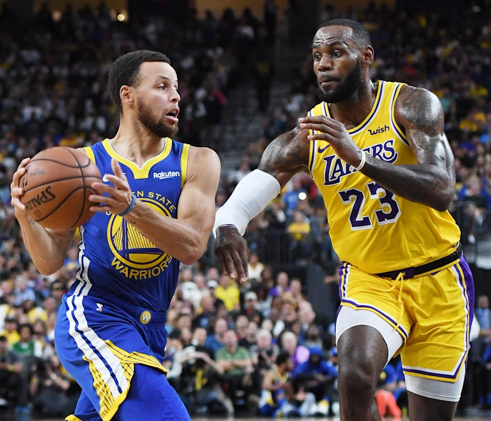 Stephen Curry #30 of the Golden State Warriors drives against LeBron James #23 of the Los Angeles Lakers during their preseason game at T-Mobile Arena on October 10, 2018 in Las Vegas, Nevada. The Lakers defeated the Warriors 123-113. NOTE TO USER: User expressly acknowledges and agrees that, by downloading and or using this photograph, User is consenting to the terms and conditions of the Getty Images License Agreement.  (Photo by Ethan Miller/Getty Images)