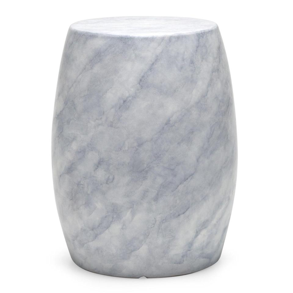 <p>This <span>MoDRN Retro Glam Round Faux-Marble Outdoor Garden Stool</span> ($80) is the perfect place for your drinks or book!</p>