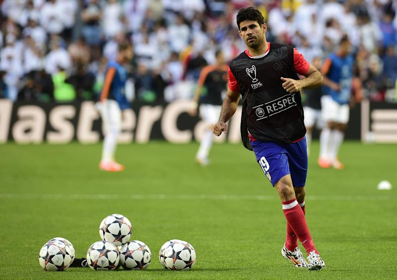 Atletico Madrid's Brazilian-born forward Diego Costa warms up prior to the UEFA Champions League Final Real Madrid vs Atletico de Madrid in Lisbon, on May 24, 2014