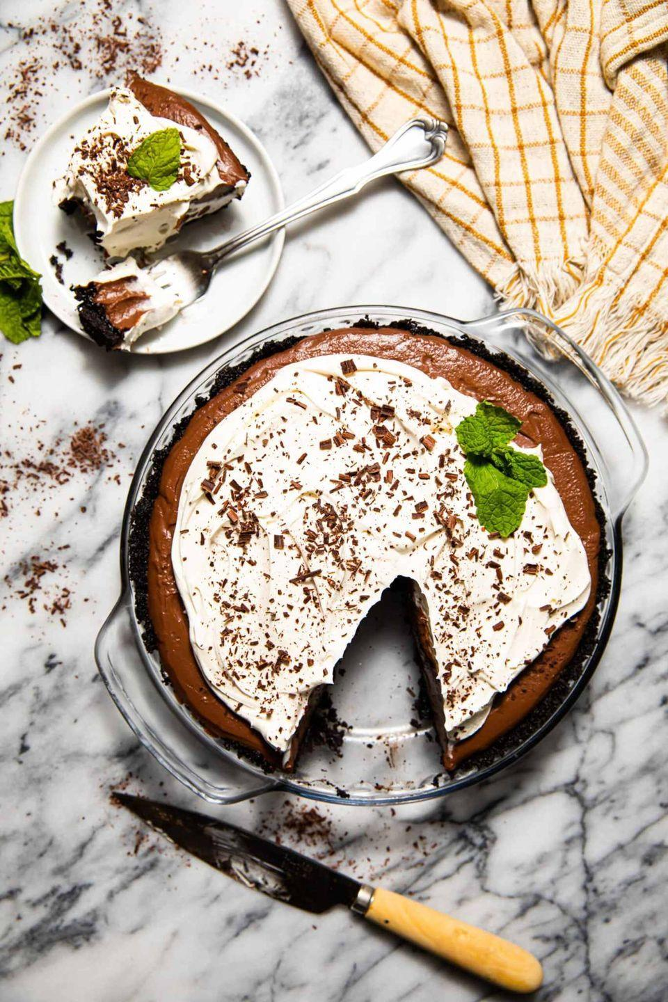 "<p>You'll be snacking on chocolate all day long, so what's a little more at dessert? This creamy pie can be stored for up to three days in the fridge, meaning the fun can last practically all week.</p><p><a href=""https://www.butterbeready.com/mocha-chocolate-cream-pie/"" rel=""nofollow noopener"" target=""_blank"" data-ylk=""slk:Get the recipe at Butter Be Ready »"" class=""link rapid-noclick-resp""><em>Get the recipe at Butter Be Ready </em><strong>»</strong></a></p>"