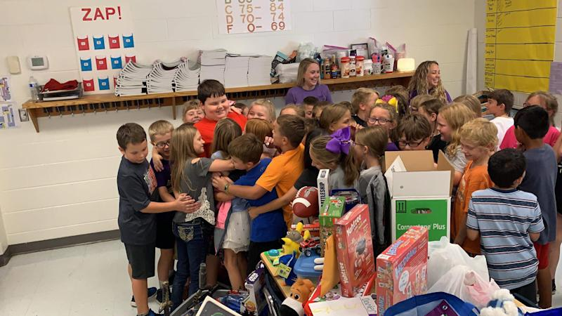Daniel Hunt in a group hug with third-graders at Philadelphia Elementary School after they surprised him with toys. (Photo: Philadelphia Elementary School, Kristen Hunt Wilburn)