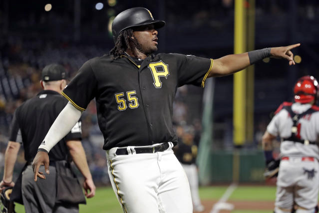 Pittsburgh Pirates' Josh Bell points after scoring on a single by Jose Osuna during the seventh inning of the team's baseball game against the St. Louis Cardinals in Pittsburgh, Friday, Sept. 6, 2019. (AP Photo/Gene J. Puskar)