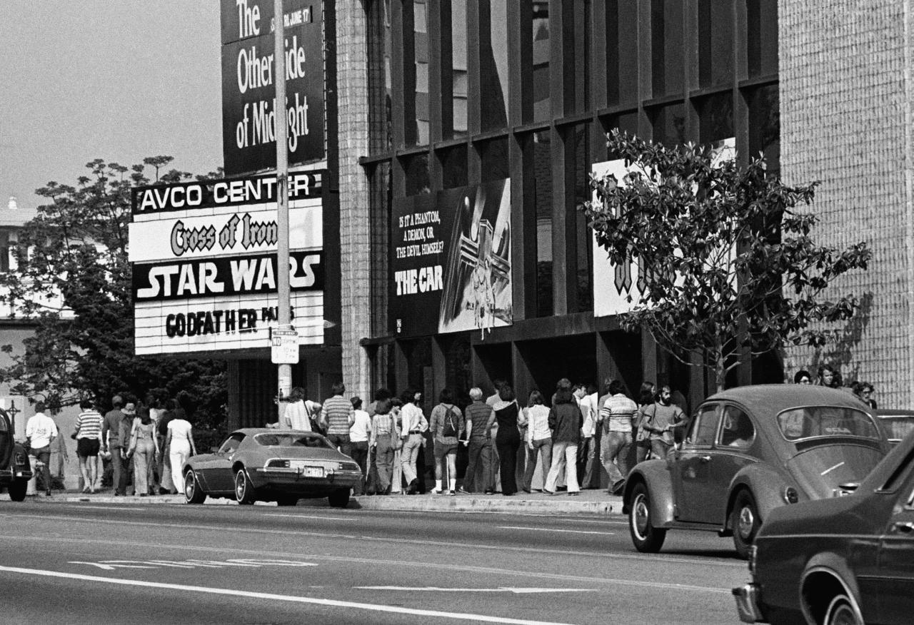 "** FILE ** In this June 7, 1977 file photo, theater goers wait in lines in front of the Avco Center Theater in Los Angeles to see ""Star Wars."" (AP Photo, file)"