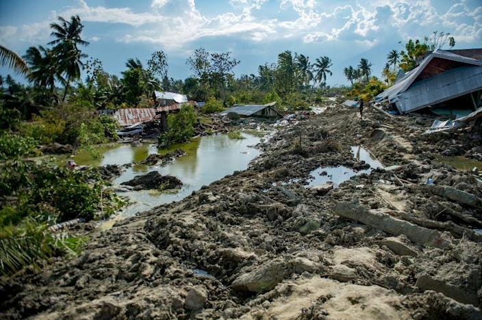 Many places have been hit by damaging liquefaction (AFP Photo/Bay ISMOYO)