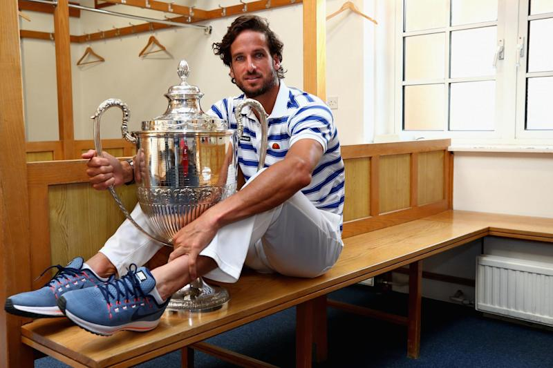 Feliciano Lopez of Spain poses with the trophy in the locker room after winning the 2017 men's singles final at Queen's: Getty Images
