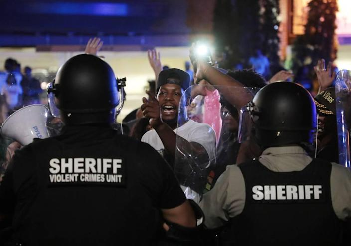 A protester yells at members of the Sheriff's violent crimes unit Thursday during a protest in downtown Rock Hill.