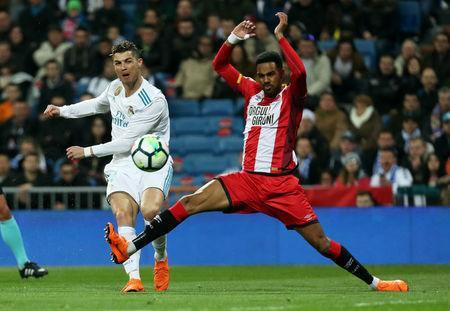 Soccer Football - La Liga Santander - Real Madrid vs Girona - Santiago Bernabeu, Madrid, Spain - March 18, 2018 Real Madrid's Cristiano Ronaldo shoots at goal REUTERS/Sergio Perez