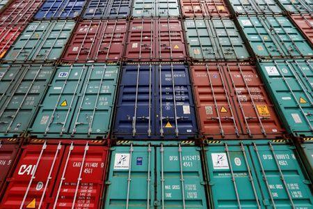 FILE PHOTO: A stack of shipping containers are pictured in the Port of Miami in Miami, Florida, U.S., May 19, 2016. REUTERS/Carlo Allegri