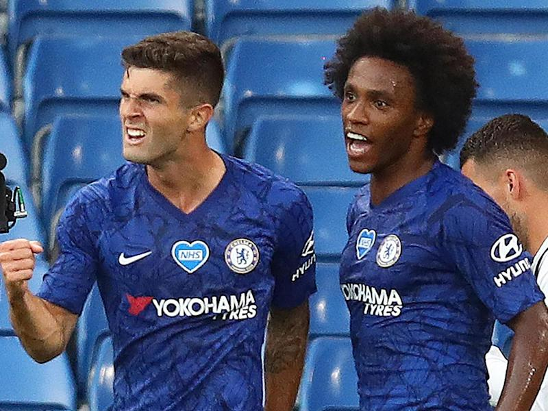 Chelsea's goalscorers Christian Pulisic (left) and Willian celebrate together: POOL/AFP via Getty Images