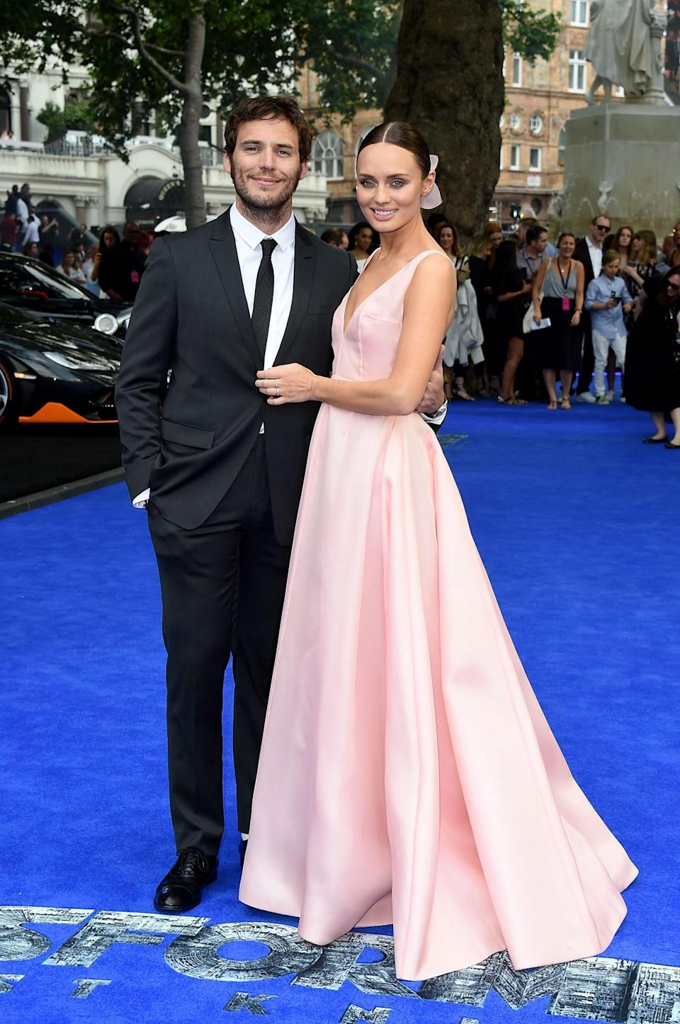 <p>British designer Emilia Wickstead rustled up this pale pink number for Laura, which she wore as she took to the red carpet with husband Sam for her new film's premiere. <br><em>[Photo: Getty]</em> </p>