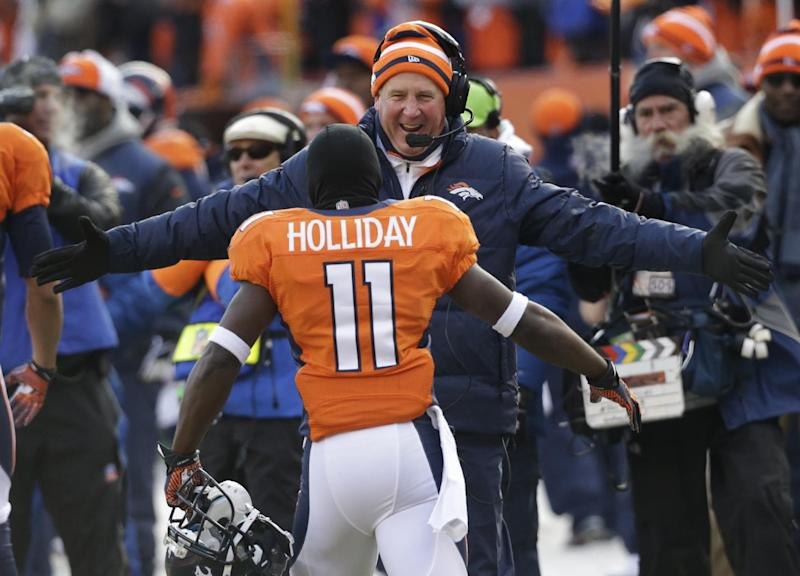 Denver Broncos wide receiver Trindon Holliday is greeted by Denver Broncos coach John Fox after running a punt return back 90 yards for a touch down against the Baltimore Ravens in the first quarter of an AFC divisional playoff NFL football game, Saturday, Jan. 12, 2013, in Denver. (AP Photo/Ed Andrieski)