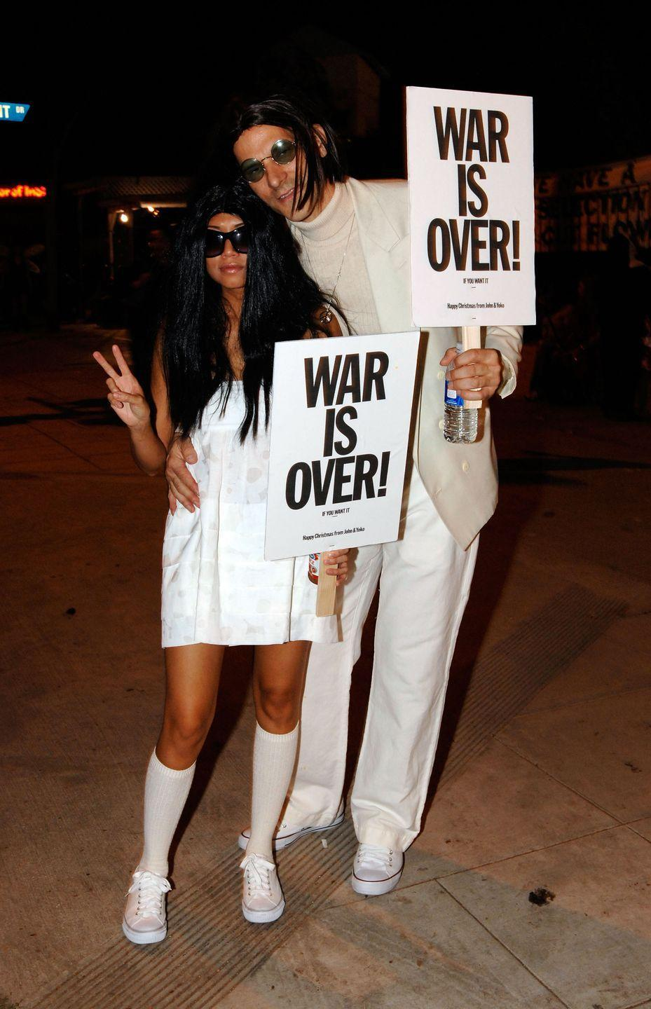 """<p>Channel one of the most iconic couples from the '70s with matching """"War Is Over!"""" signs and all-white ensembles. </p><p><a class=""""link rapid-noclick-resp"""" href=""""https://www.amazon.com/NIEEPA-Vintage-Polarized-Sunglasses-Glasses/dp/B0768B82VQ?tag=syn-yahoo-20&ascsubtag=%5Bartid%7C10070.g.23122163%5Bsrc%7Cyahoo-us"""" rel=""""nofollow noopener"""" target=""""_blank"""" data-ylk=""""slk:SHOP ROUND SUNGLASSES"""">SHOP ROUND SUNGLASSES</a></p>"""