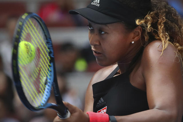 Naomi Osaka of Japan hits a return shot while competing against Julia Goerges of Germany in their third round women's singles match in the China Open at the National Tennis Stadium in Beijing, Thursday, Oct. 4, 2018. (AP Photo/Mark Schiefelbein)