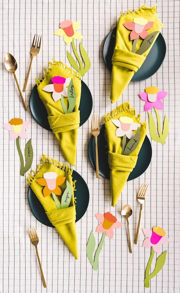"""<p>It doesn't get easier than this! These sweet daffodil """"bouquets"""" are a combination of cardstock and a simple napkin fold technique—and they double as place cards.</p><p><strong>Get the tutorial at <a href=""""https://thehousethatlarsbuilt.com/2019/04/daffodil-napkin-bouquet.html/"""" target=""""_blank"""">The House That Lars Built</a>.</strong></p><p><strong><a class=""""body-btn-link"""" href=""""https://www.amazon.com/YCC-Linen-Polyester-Restaurant-Thanksgiving/dp/B0765CKDSL?tag=syn-yahoo-20&ascsubtag=%5Bartid%7C10050.g.3115%5Bsrc%7Cyahoo-us"""" target=""""_blank"""">SHOP YELLOW NAPKINS</a><br></strong></p>"""