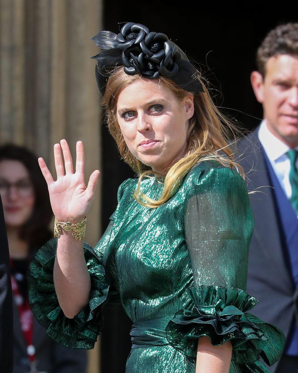 """<p>For Ellie Goulding and Caspar Jopling's August 2019 wedding, Princess Beatrice of York wore a detailed gold <a href=""""https://www.townandcountrymag.com/style/jewelry-and-watches/a36521622/cuffs-accessories-jewelry/"""" rel=""""nofollow noopener"""" target=""""_blank"""" data-ylk=""""slk:cuff bracelet"""" class=""""link rapid-noclick-resp"""">cuff bracelet</a>.<br></p>"""