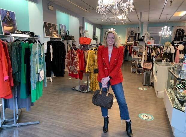 Mary Beth Campbell, owner of Luxury Market in Charlottetown, says her customers are eschewing fast fashion in favour of quality goods, which when sourced second-hand can be much more affordable.  (Sara Fraser/CBC - image credit)
