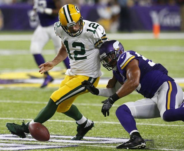 Aaron Rodgers and the Packers are off to a slow start on offense (AP)