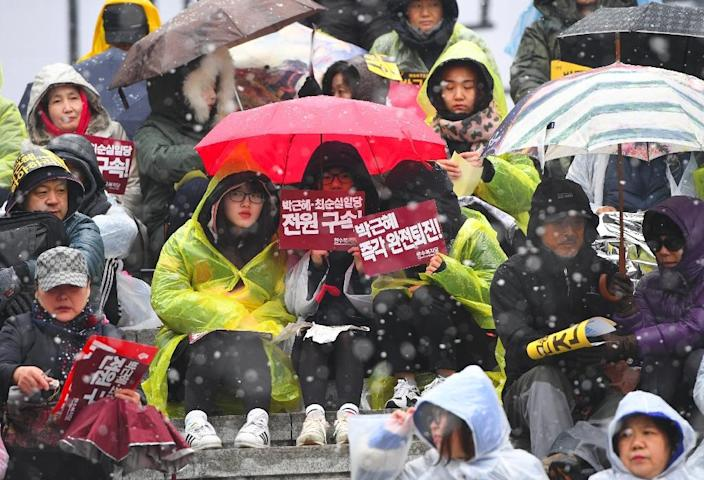 Ousted South Korean President Park Geun-Hye's role in a major corruption scandal had triggered mass anti-government protests (AFP Photo/JUNG Yeon-Je)