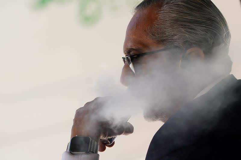 FILE PHOTO: A man uses a vaping product in the Manhattan borough of New York