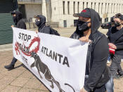 """Camden Hunt poses for a picture at a rally on Saturday, March 20, 2021, across from the Georgia state Capitol in Atlanta to demand justice for the victims of shootings at massage businesses days earlier. A 21-year-old white man is accused of killing eight people, six of them women of Asian descent, at three Atlanta-area massage businesses Tuesday. Hunt said she came out to the rally Saturday to """"show Black and Asian solidarity."""" (AP Photo/Kate Brumback)"""