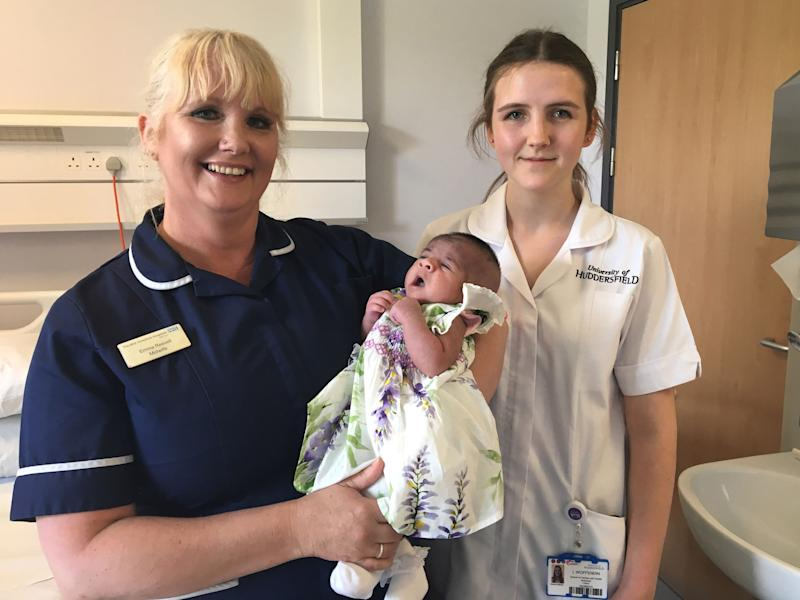 Laura Woffendin, from Pontefract, Yorkshire, with midwife Emma Reevell, 50, and Noor Fatima - the first baby Laura delivered.
