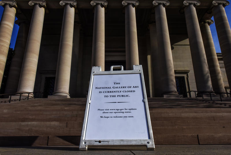 WASHINGTON, DC - March 14: A sign bearing bad news on the steps of the National Gallery of Art, west building, as Smithsonian Museums, Galleries & the Zoo close to the public due to COVID-19 fears, in Washington, DC. (Photo by Bill O'Leary/The Washington Post via Getty Images)