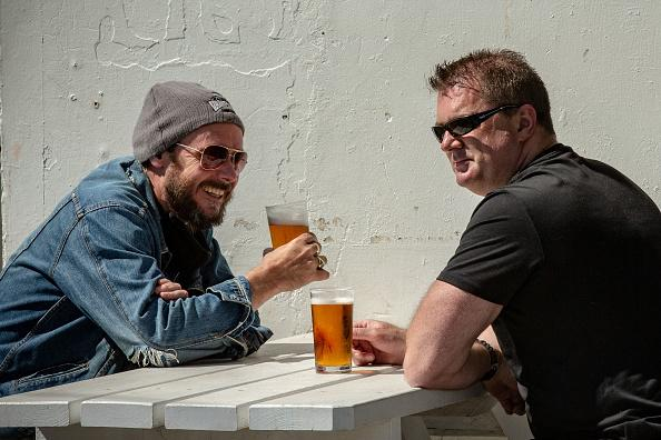 People enjoy a drink at The Esplanade Hotel in St Kilda in Melbourne, Australia.